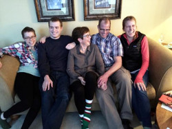 Rev. Christine Bellefeuille '82 and Ted Olson '82 with their family at the holidays.
